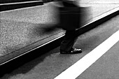 Action, Activity, Alone, B&W, Black-and-White, Blurred, Business, Businessman, Businessmen, Businesspeople, Businessperson, Coming, Commuter, Commuting, Contemporary, Curb, Detail, Details, Economy, Executive, Executives, Exterior, Feet, Foot, Goal, Goin