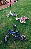 Amusement, Bicycle, Bicycles, Bike, Bikes, Biking, Child, Childhood, Children, Color, Colour, Concept, Concepts, Cycle, Cycles, Daytime, Exterior, Fun, Grass, Kid, Kids, Lawn, Leisure, Outdoor, Outdoors, Outside, Park, Parks, Play, Playground, Playground