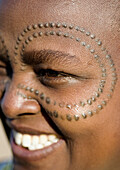 African woman with marks in the skin. Tanzania