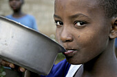 African girl eating. Tanzania.