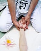 Activity, Adult, Adults, Alternative medicine, Arm, Arms, Body care, Chill out, Chilling out, Color, Colour, Contemporary, Female, Floor, Floors, Hand, Hands, Health, Healthy, Human, Indoor, Indoors, Inside, Interior, Kneeling, Male, Man, Massage, Massage