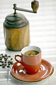 Beverage, Beverages, Black coffee, Close up, Close-up, Closeup, Coffee, Coffee mill, Coffee mills, Color, Colour, Concept, Concepts, Cup, Cups, Drink, Drinks, Espresso, Food, Indoor, Indoors, Inside, Interior, Nourishment, Object, Objects, Old fashioned,