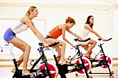Activity, Adult, Adults, Body, Color, Colour, Contemporary, Cycle, Cycles, Dynamism, Exercise, Exercise bicycle, Exercise bicycles, Exercise bike, Exercise bikes, Female, Fit, Fitness, Gym, Gymnasium, Gymnasiums, Gyms, Human, Indoor, Indoors, Interior, Ma