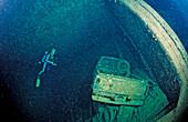 Scuba diver and Truck wreck in Blue Belt shipwreck, Sudan, Africa, Red Sea