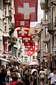 Swiss flags over pedestrian area Multergasse, St. Gallen, Canton of St. Gallen, Switzerland