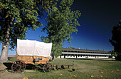 Cavalry barracks and wagon. Old West Army Outpost (c. 1849). Fort Laramie National Historic Site. Wyoming. USA