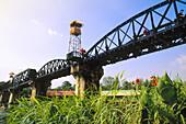 The Bridge over River Kwai (aka Death Railway Bridge ) viewed from the town. Kanchanaburi. Thailand