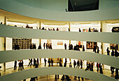 Crowded gallery view, Guggenheim museum, by Frank Lloyd Wright, built in 1959. New York City. USA