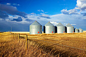 Grain silos, landscape with dramatic sky. Stand Off. Alberta, Canada