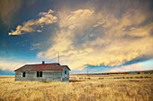 House, landscape with dramatic sky. Cardston. Alberta, Canada