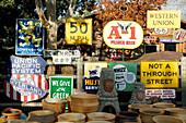 Antique advertising signs at antique and crafts market. Sedona. Arizona, USA