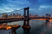 Aerial view from Brooklyn at dusk. Manhattan and Brooklyn bridges and Lower Manhattan. New York city. USA.