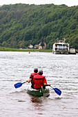 Two people kayaking on river Elbe between Rathen and Dresden, Saxony, Germany