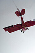 A red model airplane flying, Toy