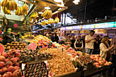 Barcelona,market hall La Boqueria,fruit and vegetable stall,people