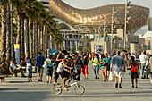 Spain Barcelona beach Platja de la Barceloneta, promenade, people, background fish sculture by Frank Gehry