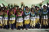 south pacific  Fiji Vitu Levu Nananu I Ra Island school class, children waving with their hands