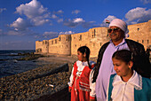 Alexandria turkish fortress, father and daughters at fore. Egypt