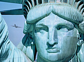 Statue of Liberty with plane. New York City. USA