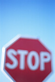 Blurred, Color, Colour, Communicate, Communication, Communications, Concept, Concepts, Daytime, Detail, Details, Exterior, Outdoor, Outdoors, Outside, Red, Road, Road sign, Road Signs, Roads, Stop, Symbol, Symbols, Thoroughfare, Thoroughfares, Traffic si