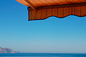Awning, Awnings, Blue, Blue sky, Calm, Calmness, Color, Colour, Concept, Concepts, Daytime, Exterior, Horizon, Horizons, Horizontal, Nature, Outdoor, Outdoors, Outside, Peaceful, Peacefulness, Quiet, Quietness, Scenic, Scenics, Sea, Seascape, Seascapes,
