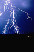 Anger, Bolt, Bolts, Color, Colour, Danger, Electric power, Electricity, Energy, Exterior, Hazard, Light, Lightning, Meteorology, Natural phenomena, Natural phenomenon, Nature, Night, Nighttime, Outdoor, Outdoors, Outside, Pain, Power, Rage, Scenic, Sceni