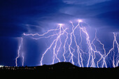 Anger, Bolt, Bolts, Cloud, Clouds, Color, Colour, Danger, Electric power, Electricity, Energy, Exterior, Hazard, Horizontal, Light, Lightning, Meteorology, Natural phenomena, Natural phenomenon, Nature, Night, Nighttime, Outdoor, Outdoors, Outside, Power