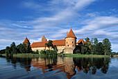 Gothic castle (XIV-XVth century). Lake Galve, Trakai. Lithuania.
