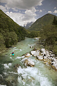 Turquoise Waters of the Soca River. Julian Alps with Kayaker. Soca. Primorska. Slovenia.
