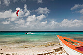 Beach View with Fishing Boat & Kite Surfer. Pink Beach. Bonaire. Netherlands Antilles.