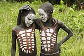 Make-up. Surma child. Near Kibish. Ethiopia.