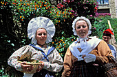 women in provencal costumes, Bormes-les-Mimosas, Provence, France, Europe