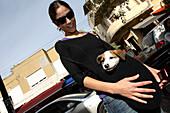 Woman with dog in bag, Sheinkin Street, Tel Aviv, Israel