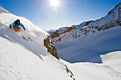 Skier freeriding in Guspis valley, Gemsstock skiing region, Andermatt, Canton Uri, Switzerland
