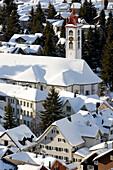 View to snow covered Parish Church St. Peter and Paul, Andermatt, Canton Uri, Switzerland