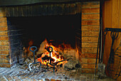 Chimney, Chimneys, Close up, Close-up, Closeup, Color, Colour, Fire, Fireplace, Fireplaces, Flame, Flames, Heat, Heating, Home, Horizontal, Hot, Warm up, Warm-up, Warming up, C47-283821, agefotostock
