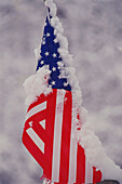 U.S. flag partly furled with snow on it. Monroe County. Indiana. USA