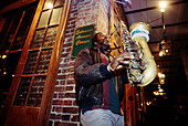 Jazzman playing saxo in Bourbon Street. New Orleans. Louisiana. USA