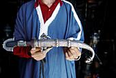 Riding sabre sold in antiques shop. Moussem of the Brides. Atlas. Morocco.