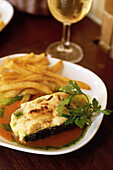 Spain. Andalusia. Jerez. Local cooking tapas. Courgette (summer squash) au gratin and Sherry at the restaurant Gallo Azul
