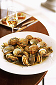 Spain. Andalusia. Jerez. Local cooking tapas, clams, artichokes and Sherry at the restaurant Gallo Azul