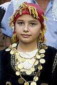 Young girl attending a wedding. Anogia. Crete. Greece.
