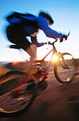 ability, activity, adult, bicycle, bicyclist, biker, blurred motion, Color image, contemporary, cycle, cycling, day, energy, exercise, fit, health, healthy, human, leisure, Male, Man, Man only, motion, mountain biking, moving, one, one person, outdoor, pe