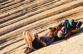 Hiker resting and writing at Snow Canyon State Park. Utah. USA