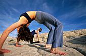 Practicing yoga at Snow Canyon State Park. Utah, USA