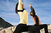 Women practicing yoga at Snow Canyon State Park. Utah, USA