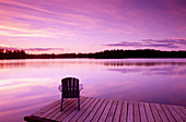Lifestyles. Early dusk. Adirondack chair at lake. Near Anchorage. Southcentral Alaska. USA.