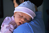Newborn sleeping on mother s shoulder