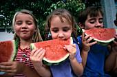 Friends eating watermelon