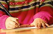 School child writing